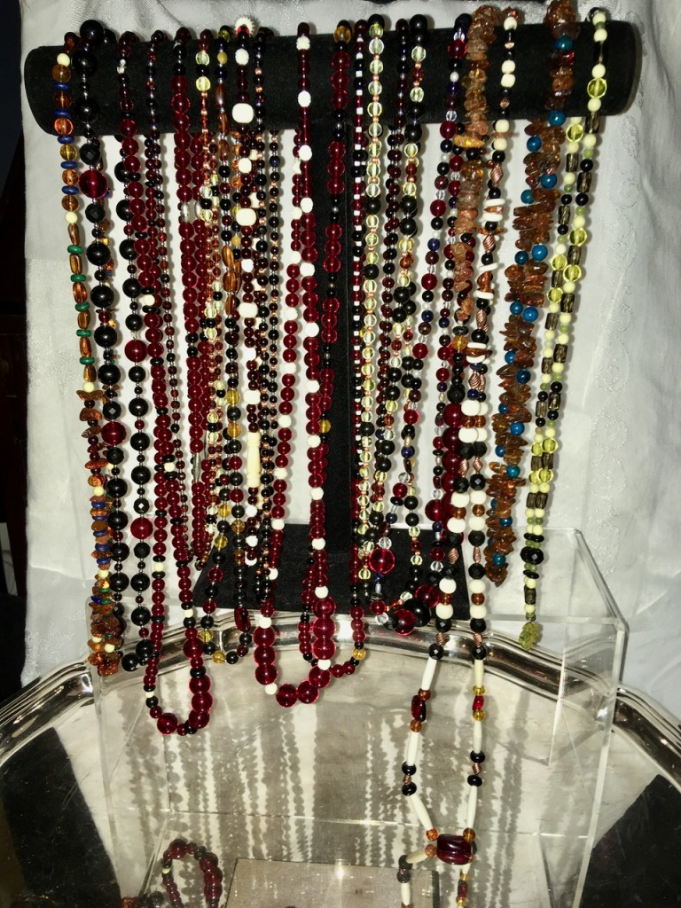 Array of Goddess Gemstone necklaces comprised largely of amber & jet, photo dated ~Hallows 2019